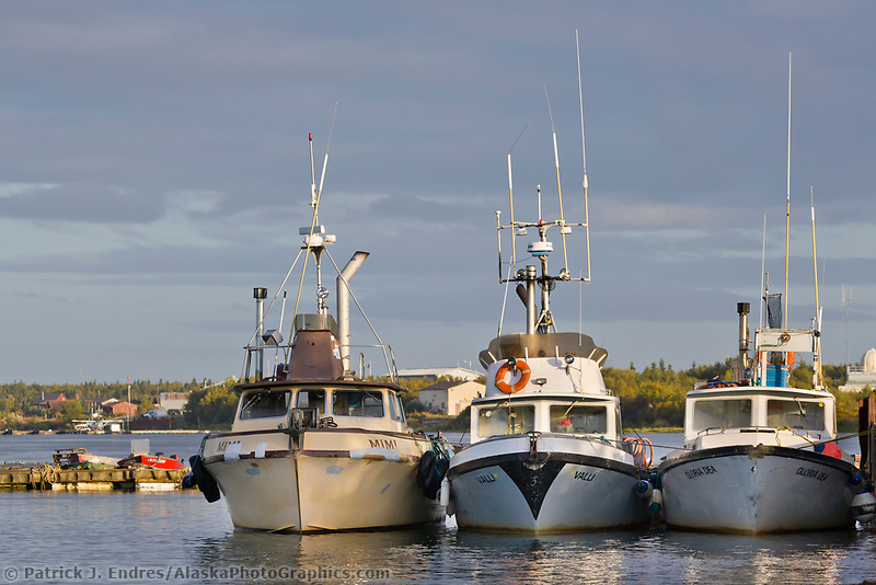 Boats at a dock along the Naknek river in the town of King Salmon, Alaska.
