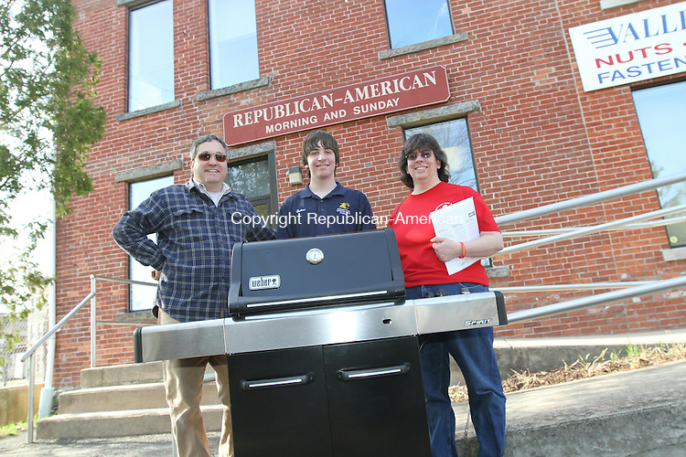TORRINGTON, CT - 15 April, 2011 - 041511MO01 - The Bodnar family, from left, Michael, Andrew and Robin, won a new Weber Spirit gas grill from the Republican-American, the grand prize in a drawing Robin Bodnar entered during a visit to the Home & Business Expo hosted by the Chamber of Commerce of Northwest Connecticut. Jim Moore Republican-American.