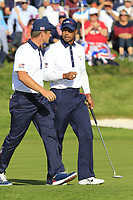 Tiger Woods (Team USA) sinks his putt on the 11th green during Saturday's Foursomes Matches at the 2018 Ryder Cup 2018, Le Golf National, Ile-de-France, France. 29/09/2018.<br /> Picture Eoin Clarke / Golffile.ie<br /> <br /> All photo usage must carry mandatory copyright credit (&copy; Golffile | Eoin Clarke)