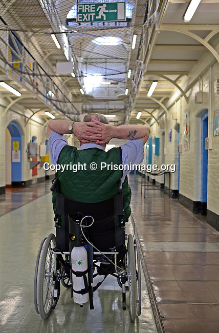 An elderly wheelchair bound prisoner on a wing of Wandsworth prison..HMP Wandsworth in South West London was built in 1851 and is one of the largest prisons in Western Europe. It has a capacity of 1456 prisoners.