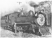 RGS 4-6-0 #20 at Dolores ash pit with engineer using oil can by train.<br /> RGS  Dolores, CO  May-July 1947