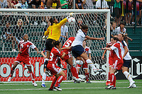 Canada (CAN) goalkeeper Karina LeBlanc (1) punches the ball clear as Shannon Boxx (7) of the United States (USA) goes for a header. The United States (USA) Women's National Team defeated Canada (CAN) 1-0 during an international friendly at Marina Auto Stadium in Rochester, NY, on July 19, 2009.