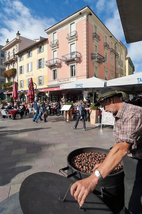 Switzerland, Ticino, Lugano: selling chestnuts at Piazza delle Riforma   Schweiz, Tessin, Lugano: Maronenverkaeufer auf der Piazza della Riforma