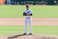 Glendale Desert Dogs relief pitcher Matt Wivinis (30), of the New York Yankees organization, gets ready to deliver a pitch during an Arizona Fall League game against the Scottsdale Scorpions at Camelback Ranch on October 16, 2018 in Glendale, Arizona. Scottsdale defeated Glendale 6-1. (Zachary Lucy/Four Seam Images)
