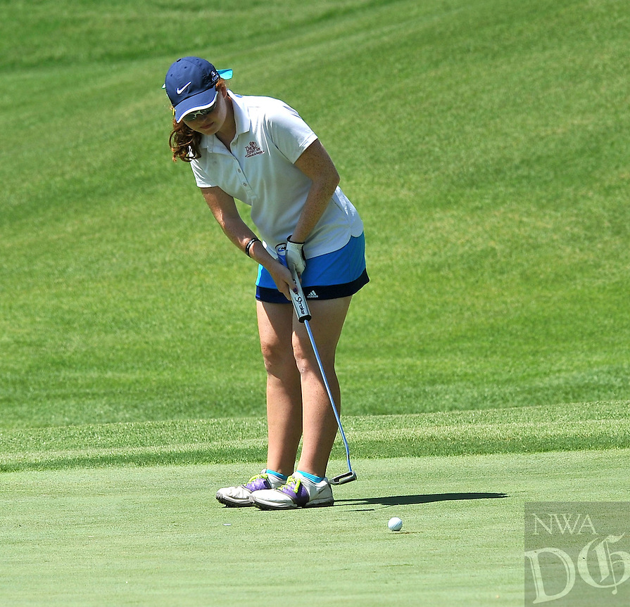 NWA Media/Michael Woods --06/24/2014-- w @NWAMICHAELW...Audrey Pulliam from Little Rock makes a putt Tuesday morning during the last round of the ASGA Stroke Play tournament at Shadow Valley Country Club in Rogers.
