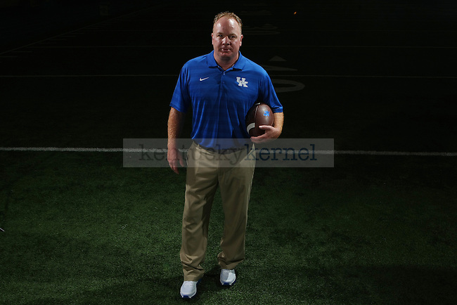 UK football head coach Mark Stoops poses for a photo during UK football media day at Nutter Field House in Lexington, Ky.,on Friday, August 8, 2014. Photo by Michael Reaves | Staff