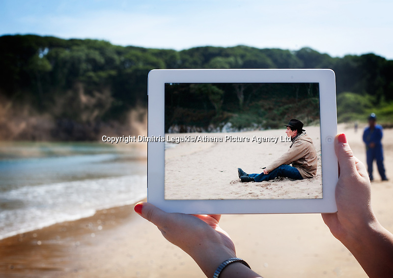 """Pictured: Barafundle Bay in Pembrokeshire where scenes of the film Third Star were filmed.<br /> Re: A pair of film lovers have turned detective to track down locations from films and TV shows - and capture the exact scenes on their iPads.<br /> Tiia Ohman, 25, and Satu Walden, 26, travel hundreds of miles across Britain tracing the footsteps of their movie heroes to photograph the action spots.<br /> The two young women who live in Cardiff painstakingly recreate their favourite scenes using an iPad or phone screens to stand in for the stars.<br /> They've brought to life scenes from silver screen blockbuster such as Harry Potter, Les Miserables and Warhorse.<br /> And their """"sceneframing"""" shots also feature locations seen in Dr Who, Sherlock and Merlin.<br /> Tiia said: """"This combines our love of TV and movies, photography, travel and much more.<br /> """"What started as an epic road trip to filming locations all over the UK eventually led to a series of photos we like to call sceneframing.<br /> """"Visiting filming locations is the perfect way to see places you wouldn't necessarily find in Lonely Planet books and travel guides.""""<br /> Tiia and Satu, originally from Finland, live in Cardiff where they spend their spare time researching film locations.<br /> Their """"fangirl quest"""" blog (www.fangirlquest.com) has already seen them cover more than 2,000 miles travelling across the country including top locations in Cardiff, Newport and Pembrokeshire."""