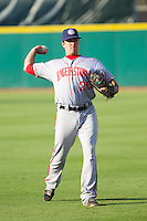 Hagerstown Suns first baseman Carlos Lopez (26) warms up in the outfield prior to the game against the Greensboro Grasshoppers at NewBridge Bank Park on June 21, 2014 in Greensboro, North Carolina.  The Grasshoppers defeated the Suns 8-4. (Brian Westerholt/Four Seam Images)