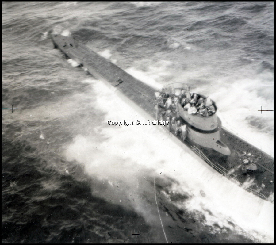 BNPS.co.uk (01202 558833)Pic: H.Aldridge/BNPS<br /> <br /> Never-before-seen photos of the incredibly-rare moment a fearsome German U-boat surrendered have been unearthed in an RAF officer's archive.<br /> <br /> The aerial images show U-570 on the surface of the north Atlantic with its crew stood on deck waiting to be taken prisoner following an air raid on their submarine.<br /> <br /> U-570 was one of only six enemy submarines to be captured intact by the Allies in the Second World War and hardly any photos showing the moment of surrender exist.<br /> <br /> The photos were discovered in an archive owned by Group Captain Montague Whittle who was in command of the RAF base in Reykjavik, Iceland.<br /> <br /> The archive is being sold by Henry Aldridge & Son for £2,000.