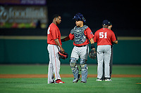 Pawtucket Red Sox pitcher Jenrry Mejia (48) and catcher Juan Centeno as manager Billy McMillon (51) argues a call with umpire Dan Merzel during an International League game against the Rochester Red Wings on June 28, 2019 at Frontier Field in Rochester, New York.  Pawtucket defeated Rochester 8-5.  (Mike Janes/Four Seam Images)
