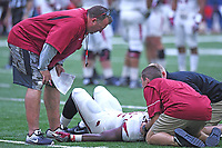 NWA Democrat-Gazette/J.T. WAMPLER Arkansas head coach Bret Bielema watches as support personnel assist Rawleigh Williams III Saturday April 29, 2017 after he was injured on a play during a red-white scrimmage. Williams left the practice in am ambulance.