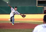 The ceremonial first pitch is thrown out at the Reno Aces game in Reno, Nev., on Saturday, April 18, 2015.<br /> Photo by Cathleen Allison