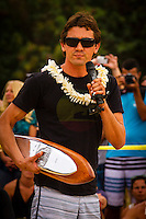 "HONOLULU, Oahu, Waimea Bay - Thursday, November 28, 2012 Former winner Greg Long (USA). -- The 28th annual Quiksilver In Memory of Eddie Aikau official opening ceremony and blessing today at Waimea Bay on the North Shore of Oahu. The ceremony  featured this year's 28 Invitees, including newly elected riders John John Florence (Hawaii), Ian Walsh (Maui), and Alex Gray (California), as well as former ""Eddie"" champions Kelly Slater (Florida), Greg Long (California), and Ross Clarke-Jones (Australia). The surfers will be joined by members of the Aikau family, including Eddie's younger brother and Invitee Clyde Aikau...When the Invitees and Alternates paddled out and grouped in the traditional surfer's circle it's about camaraderie and making a connection to the others who will ultimately share in your experience and watch out for your safety..The holding period for the Quiksilver In Memory of Eddie Aikau will commence on Saturday, December 1, and runs through  to February 28, 2013. The event requires one day of quality waves in the giant range of 20 feet or more. Waves of this size are only generated occasionally by hurricane force winds from intense storms in the Pacific NW. The elements of wind, swell height and arrival time to the island's shore must be in perfect alignment to allow a full eight hours of daytime competition..Waimea Bay was Eddie Aikau's home away from home. It was here that he saved countless lives as the Bay's first official lifeguard, and successfully rode the largest waves of his day. An early pioneer of big wave riding in Hawaii, Eddie has inspired generations of ""storm surfers"" who today roam the globe year-round in search of giant waves..The Quiksilver In Memory of Eddie Aikau has only been held a total of eight (8) times, most recently on December 8, 2009. California's Greg Long (California) took the honor that year. .Photo: joliphotos.com"
