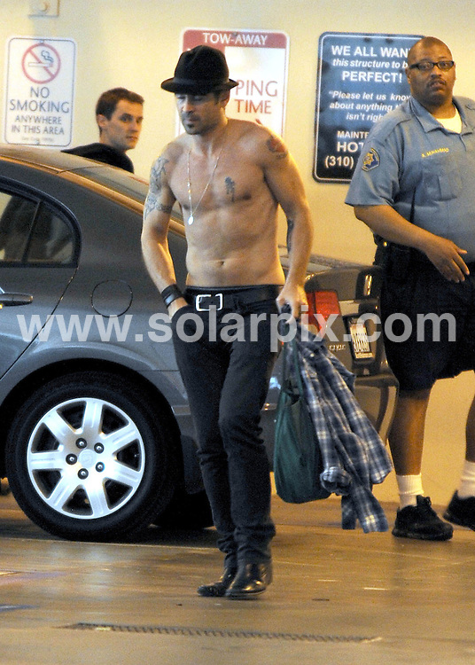 **ALL ROUND EXCLUSIVE PICTURES FROM  SOLARPIX.COM**.**£250.00 MINIMUM USAGE FEE**.**SYNDICATION RIGHTS FOR UK AND SPAIN ONLY**.Colin Farrell makes his way to his car shirtless.After spending an hour at UCLA medical center in Los Angeles USA. 26 May 2010..This pic: Colin Farrell..JOB REF: 113331         STL        DATE: 26.05.2010.**MUST CREDIT SOLARPIX.COM OR DOUBLE FEE WILL BE CHARGED**.**MUST NOTIFY SOLARPIX OF ONLINE USAGE**.**CALL US ON: +34 952 811 768 or LOW RATE FROM UK 0844 617 7637**