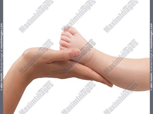 Mother holding her three month old baby son's foot in her hands. Isolated on white background with a clipping path.