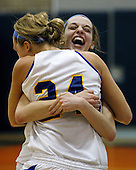 Danielle Blake gives a congratulatory hug to teammate Aleigha Wylie (24) following their Regional Final victory over Clarkston at Fenton Thursday, March 20, 2011.