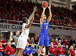VERMILLION, SD - JANUARY 24: Skyler Flatten #1 from South Dakota State University spots up for a jumper over Triston Simpson #3 from the University of South Dakota during their game Wednesday night at the Sanford Coyote Sports Center in Vermillion, SD. (Photo by Dave Eggen/Inertia)
