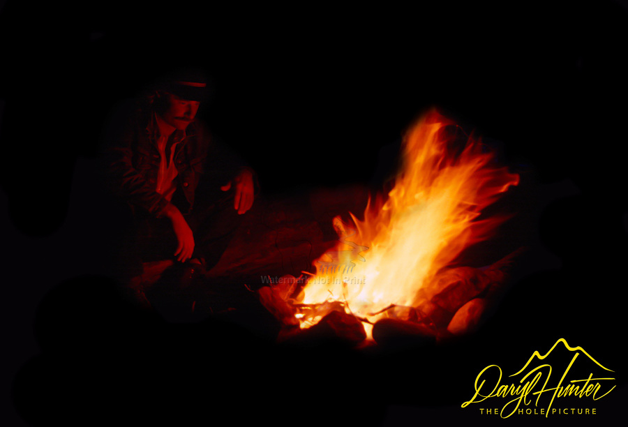 Cowboy sitting at the campfire