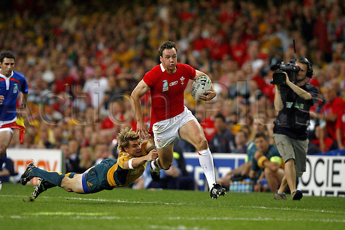 15 September 2007: Welsh wing Mark Jones evades the tackle from Drew Mitchell during the IRB Rugby World Cup pool game between Wales and Australia played at The Millennium Stadium, Cardiff. Australia won the game 32-20. Photo: Neil Tingle/Actionplus....070915 rugby union player