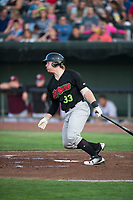 Great Falls Voyagers catcher Gunnar Troutwine (33) follows through on his swing during a Pioneer League game against the Idaho Falls Chukars at Melaleuca Field on August 18, 2018 in Idaho Falls, Idaho. The Idaho Falls Chukars defeated the Great Falls Voyagers by a score of 6-5. (Zachary Lucy/Four Seam Images)