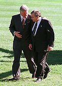 Washington, DC - October 23, 1998 -- United States President Bill Clinton returns to the White House from the Washington Summit at Wye River accompanied by National Security Advisor Sandy Berger on Thursday, October 23, 1998 after securing an agreement between the Israelis and Palestinians..Credit: Ron Sachs / CNP