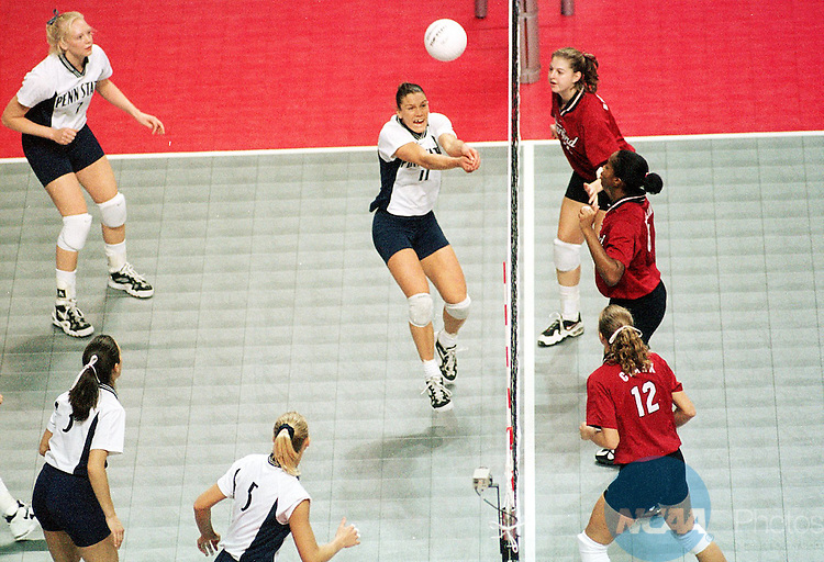 Caption: 20 DEC 1997: Penn state's Christy Cochran (11) hits the ball as her Stanford opponents Sarah Clark (12) Paula McNames (7) and Lisa Sharpley (2) look on during the Division 1 Women's Volleyball Championship held at the Spokane Arena in Spokane, WA. Stanford defeated Penn State 3 sets to 2 for the championship title. Bruce Ely/NCAA Photos.