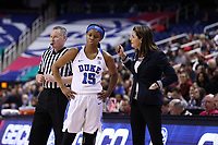 GREENSBORO, NC - MARCH 06: Head coach Joanne P. McCallie of Duke University talks with Kyra Lambert #15 during a game between Boston College and Duke at Greensboro Coliseum on March 06, 2020 in Greensboro, North Carolina.