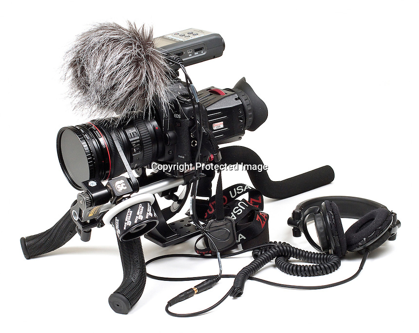 This does the job nicely. Canon 5D MKII with 24-105mm F4 lens attached, variable filter up front to allow for shallow depth of field.<br /> Zoom H4n digital sound recorder with 'dead cat' windshield (irresistible to children) and Zacuto z-finder attached to the back of the camera body.<br /> All sat on top of a Swedish Chameleon SC3 rig which can be dismantled making for easy transport