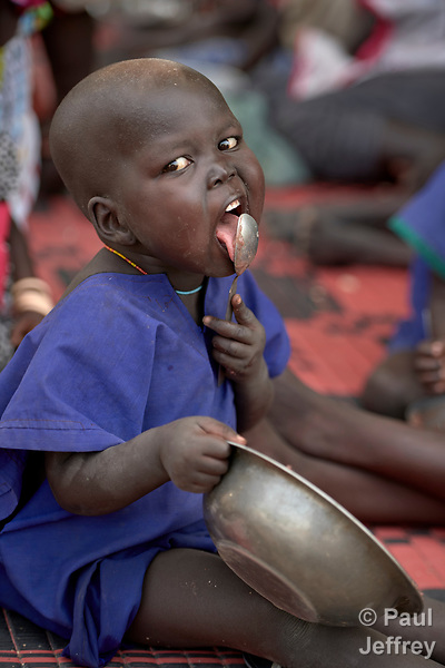 A child eats in an emergency feeding program for malnourished children at the Loreto Girls School in Rumbek, South Sudan. The school, run by the Institute for the Blessed Virgin Mary--the Loreto Sisters--of Ireland, has opened its compound to hundreds of nearby villagers facing hunger because of ongoing conflict and climate change.