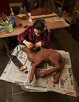 Kendra Harvey works on a clay sculpture during  Intermediate Handbuilt Ceramics (ART A301) in UAA's fine arts building.