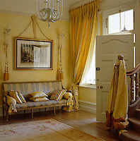 A formal elegance has been created in this classical Regency-style entrance hall