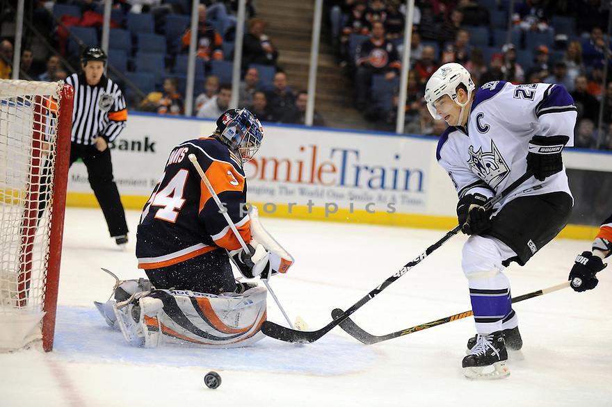 Feb 10, 2009; Uniondale, NY, USA; New York Islanders  goaltender Yann Danis (34) stops Los Angeles Kings rightwing Dustin Brown (23) with time running out in overtime period at the Nassau Coliseum. Mandatory Credit: Tomasso DeRosa-SportPics