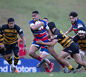 Tevita Hala gets caught by Chay Mackwood. Counties Manukau Premier 1 McNamara Cup Final between Ardmore Marist and Bombay, played at Navigation Homes Stadium on Saturday July 20th 2019.<br />  Bombay won the McNamara Cup for the 5th time in 6 years, 33 - 18 after leading 14 - 10 at halftime.<br /> Photo by Richard Spranger.