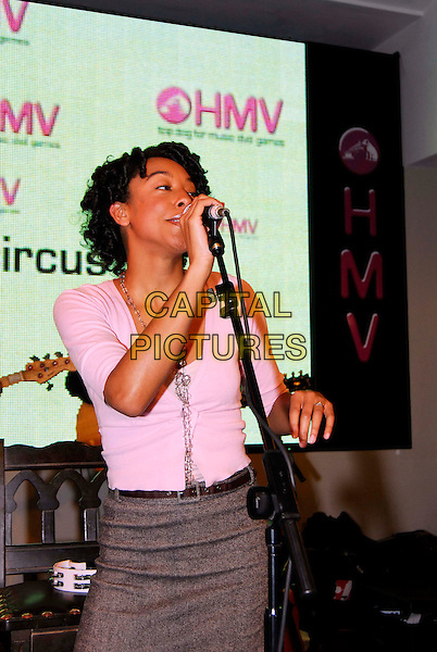 CORINNE BAILEY RAE.Instore Gig & Signing, HMV 150 Oxford Street,.London, England,.20th February 2006..half length pink top grey skirt concert music singer singing performing performance live.Ref: HT.www.capitalpictures.com.sales@capitalpictures.com.©Capital Pictures