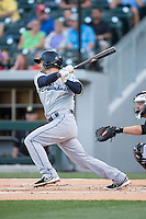 Ryan Rohlinger (2) of the Columbus Clippers follows through on his swing against the Charlotte Knights at BB&T BallPark on May 27, 2015 in Charlotte, North Carolina.  The Clippers defeated the Knights 9-3.  (Brian Westerholt/Four Seam Images)