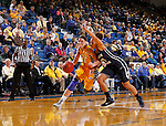 BROOKINGS, SD - NOVEMBER 14:  Megan Waytashek  #24 from South Dakota State University drives against Xojian Harry #11 from Brigham Young in the second half of their game Friday night at Frost Arena.  (Photo by Dave Eggen/Inertia)