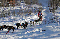 Saturday, February 24th, Knik, Alaska.  Jr. Iditarod musher Charlie Allison on the trail shortly after leaving the Knik start