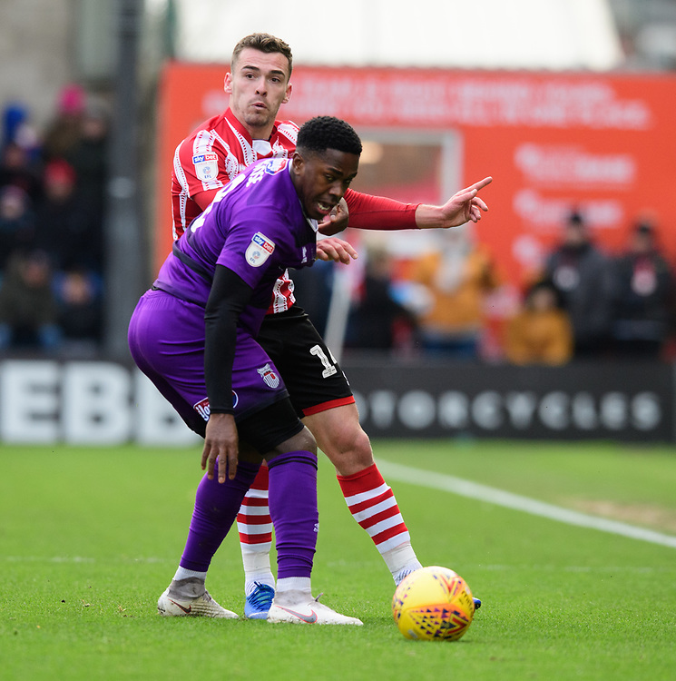 Lincoln City's Harry Toffolo vies for possession with Grimsby Town's Mitch Rose<br /> <br /> Photographer Chris Vaughan/CameraSport<br /> <br /> The EFL Sky Bet League Two - Lincoln City v Grimsby Town - Saturday 19 January 2019 - Sincil Bank - Lincoln<br /> <br /> World Copyright &copy; 2019 CameraSport. All rights reserved. 43 Linden Ave. Countesthorpe. Leicester. England. LE8 5PG - Tel: +44 (0) 116 277 4147 - admin@camerasport.com - www.camerasport.com