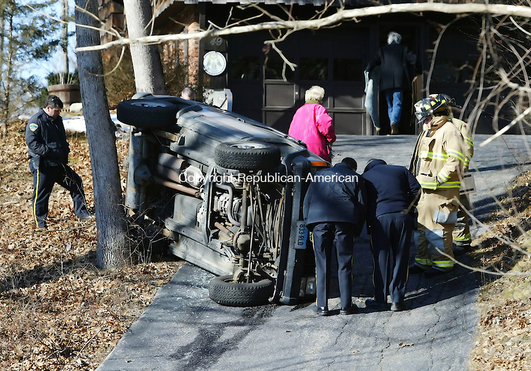 SOUTHBURY, CT, 03/06/07- 030607BZ01- <br /> Southbury Volunteer Firefighters and Southbury Police investigate the scene of a  rollover at 49 Jeremy Swamp Rd. in Southbury Tuesday afternoon.<br /> Jamison C. Bazinet Republican-American