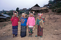 Laos, Luang Namtha Province, Ban Nammat Gao village, 12/3/03..Akha girls in the village just before they are going of to work in the fields.  The women and girls are wearing the traditional head-dress, which takes a lot of work to maintain..Photo Kees Metselaar