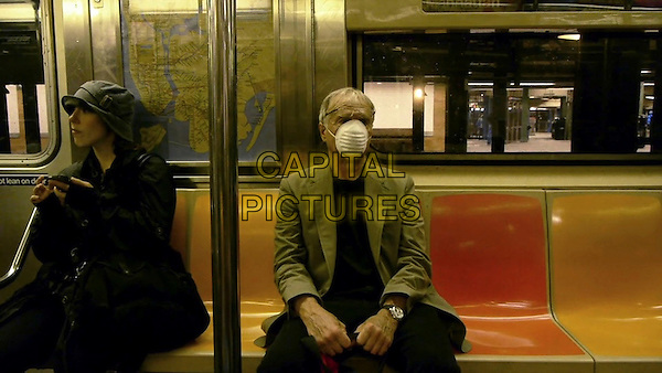 One Cut, One Life (2014) <br /> A masked Ed Pincus rides the subway in New York City<br /> *Filmstill - Editorial Use Only*<br /> CAP/KFS<br /> Image supplied by Capital Pictures