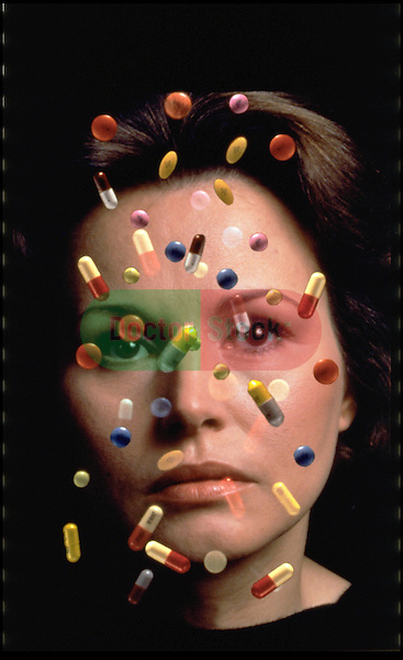 portrait of stressed woman with pills floating in front of her face