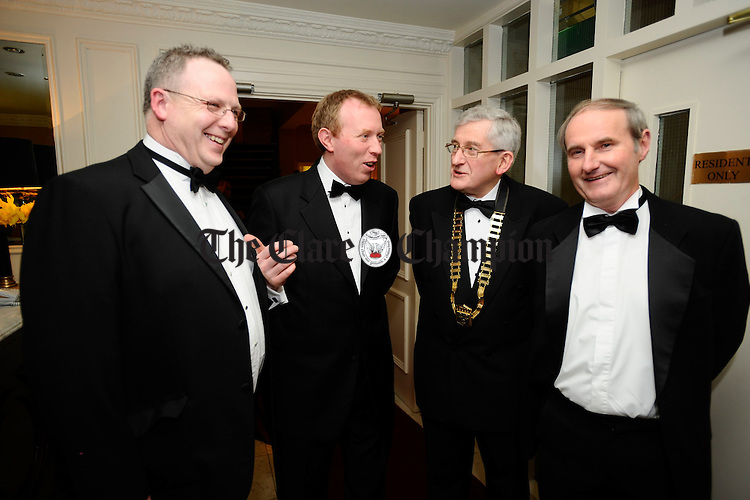 Michael Mc Dermot, NIB, Timmy Dooley, T.D. Michael Evans, Chamber President and Jarlath Gallagher,  of The Eye Care Centre at the Ennis Chamber annual Dinner in the Old Ground hotel. Photograph by John Kelly.