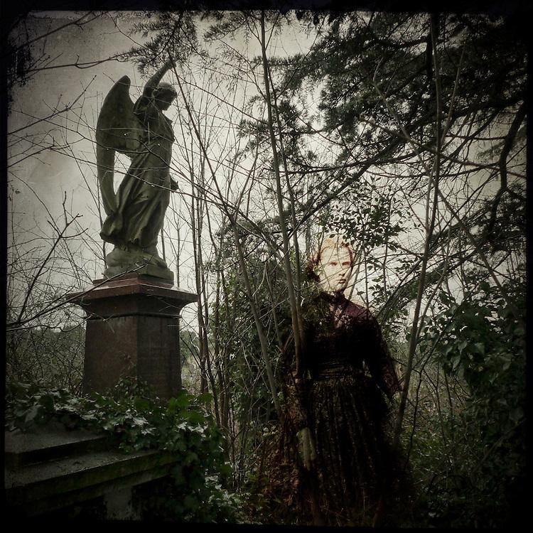 Angel memorial in graveyard