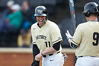 Shane Muntz (11) of the Wake Forest Demon Deacons laughs at something a teammate said during the game against the Notre Dame Fighting Irish at David F. Couch Ballpark on March 10, 2019 in  Winston-Salem, North Carolina. The Demon Deacons defeated the Fighting Irish 7-4 in game one of a double-header.  (Brian Westerholt/Four Seam Images)