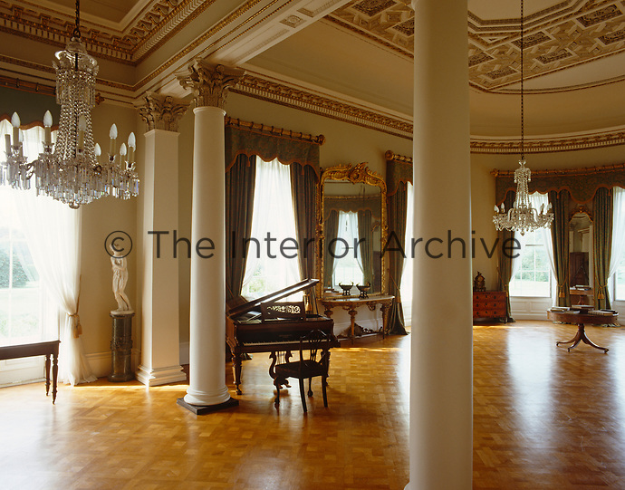 The Ballroom has a screen of Corinthian columns and a coved and coffered ceiling