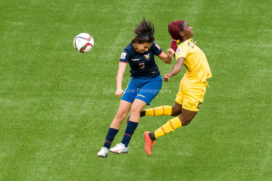June 8, 2015: Mayra OLVERA of Ecuador and Madeleine NGONO MANI of Cameroon compete for the ball with during a Group C match at the FIFA Women's World Cup Canada 2015 between Cameroon and Ecuador at BC Place Stadium on 8 June 2015 in Vancouver, Canada. Sydney Low/AsteriskImages