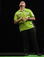 21.05.2015. London, England. Betway Premier League Darts Play-Offs.  Michael van Gerwen [NED] comes close to a finish in his semi final game with Raymond van Barneveld [NED].  Michael van Gerwen [NED] won the match.