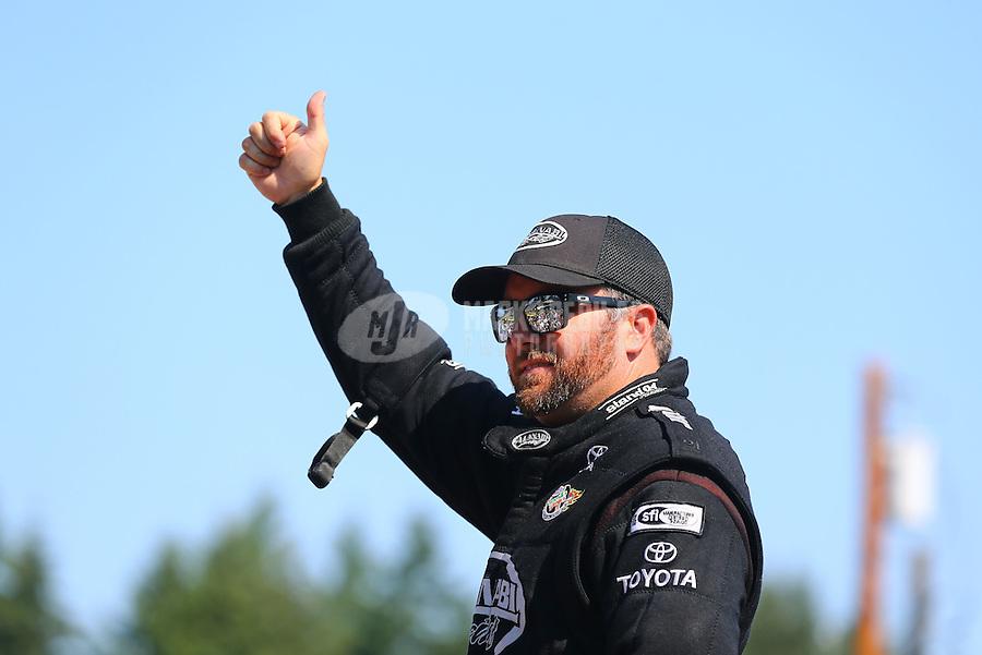 Aug. 3, 2014; Kent, WA, USA; NHRA top fuel dragster driver Shawn Langdon during the Northwest Nationals at Pacific Raceways. Mandatory Credit: Mark J. Rebilas-USA TODAY Sports