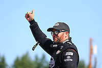 Aug. 3, 2014; Kent, WA, USA; NHRA top fuel dragster driver Shawn Langdon during the Northwest Nationals at Pacific Raceways. Mandatory Credit: Mark J. Rebilas-USA TODAY Sports